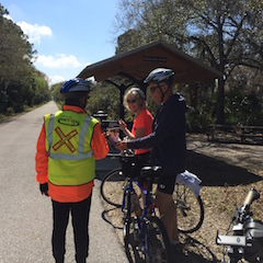 An Ambassador Patrol helps a trail visitor find local amenities