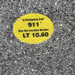 911 Emergency marker placed along the center line of the trail