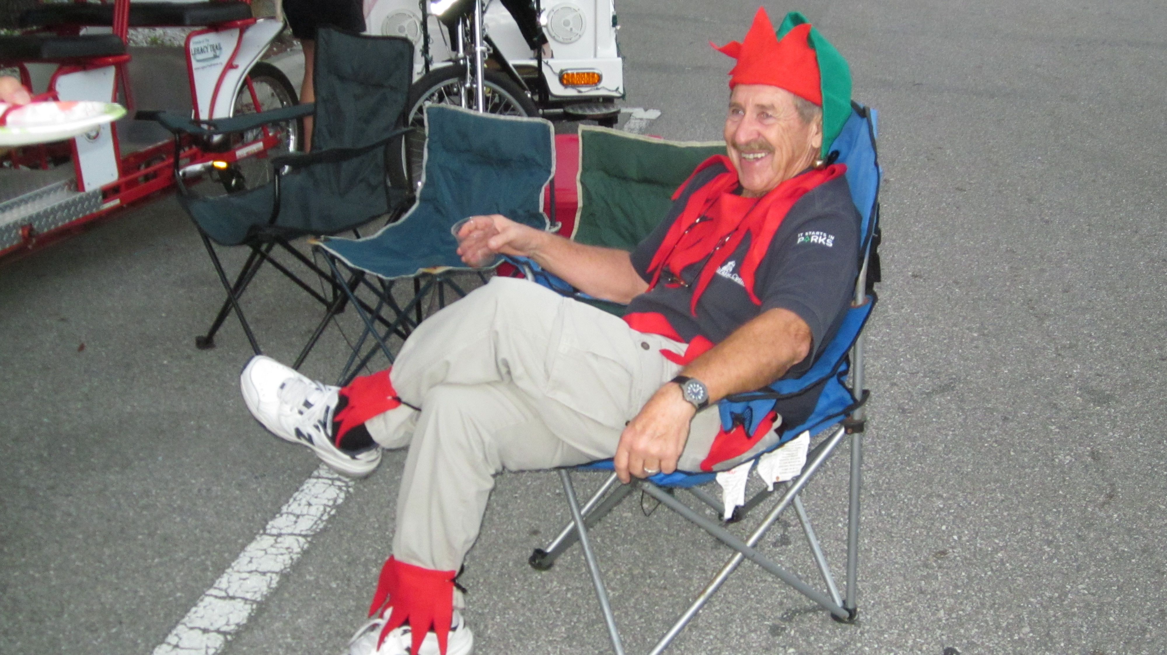 Ed Wolfenbarger relaxes before pedaling the surrey in the Sarasota Christmas Parade.