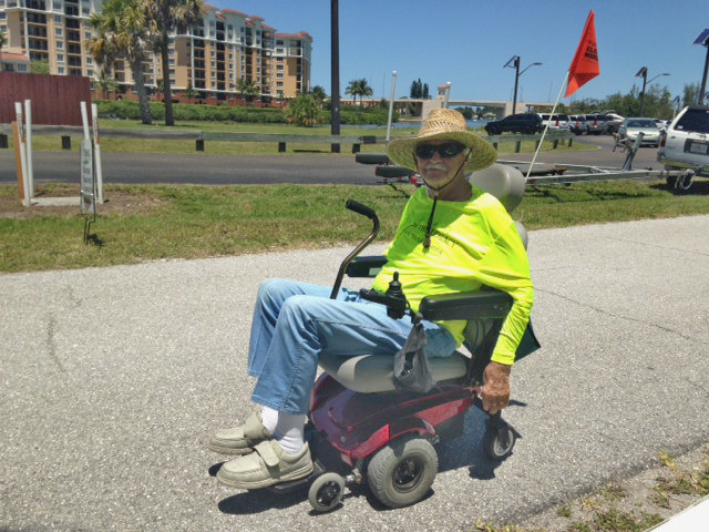 Just about every Sunday Earl rides his electric chair about 8 miles on the Trail. Today he went all the way back home to put on his Extension shirt and ride over to show us!  Super guy!<br>Picture and narrative by Darryl Lang